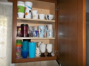 Cups and glasses in our cabinets very disorganized before we organized them.