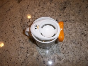 After trying several bowls and mugs we finally found a small mug that fit the Joie egg separator.