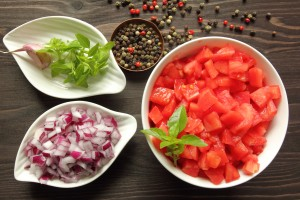 Bowls with chopped raw  tomatoes and onions