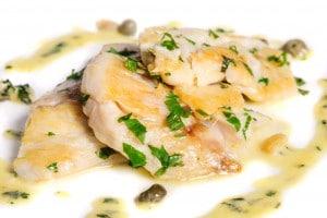Steamed Zander fresh water fish fillet with fresh herbs.