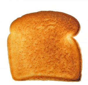 Slice of white toast on a white background.