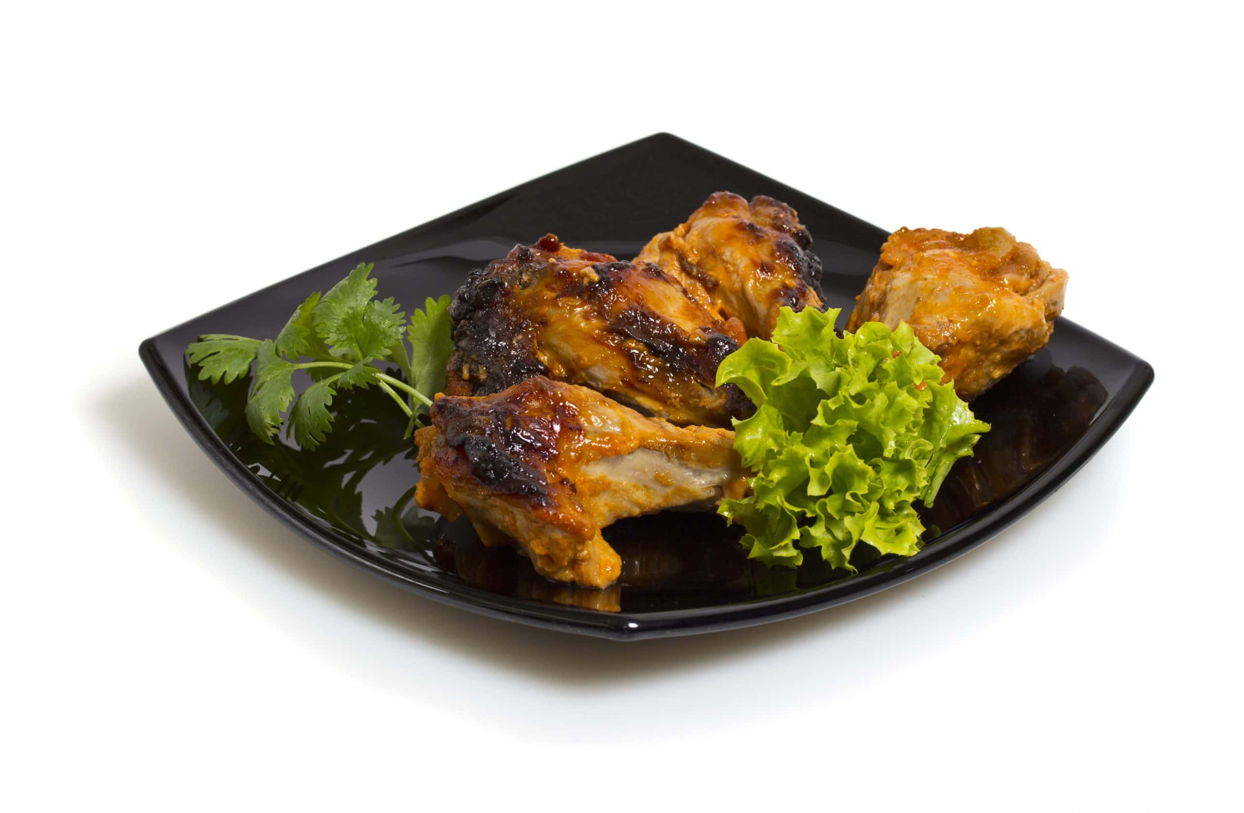 broiled chicken on black plate