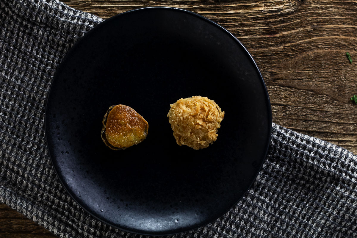 """Fried pickle recipes compared. On the right is our fried pickle compared to """"others"""" with a simple flour dredge."""