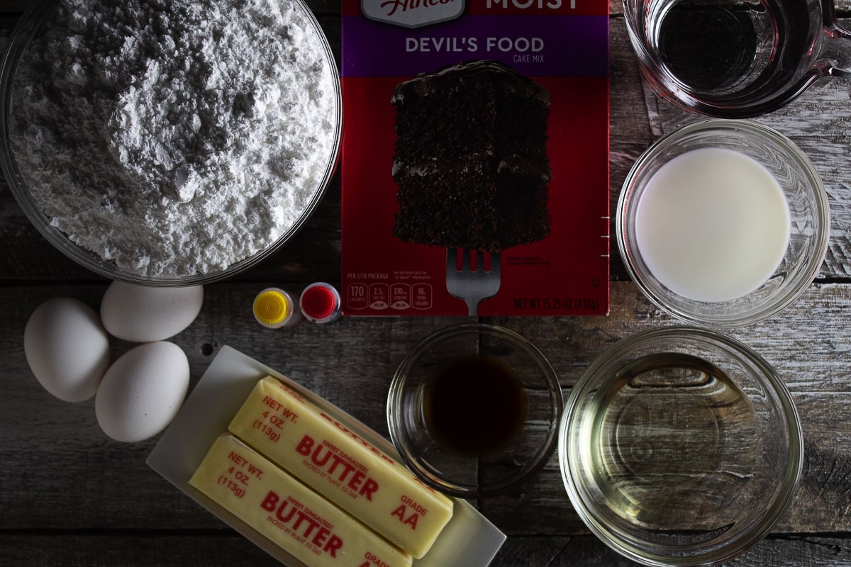 Seen here are all of the ingredients needed to make our air fryer mini ombre Halloween cakes.
