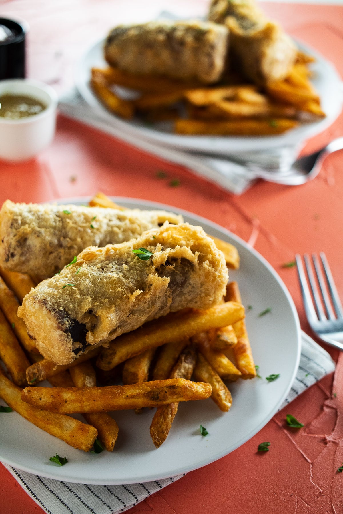 Up close image of battered sausages and fries.