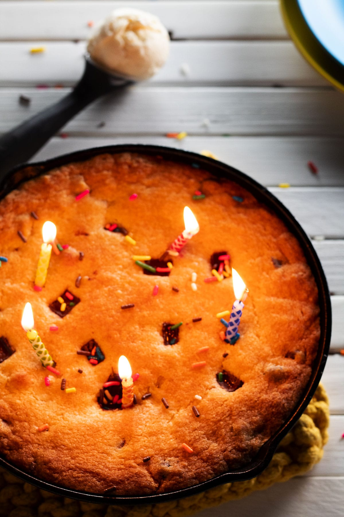 Up close birthday hot cookie dough with lit candles.