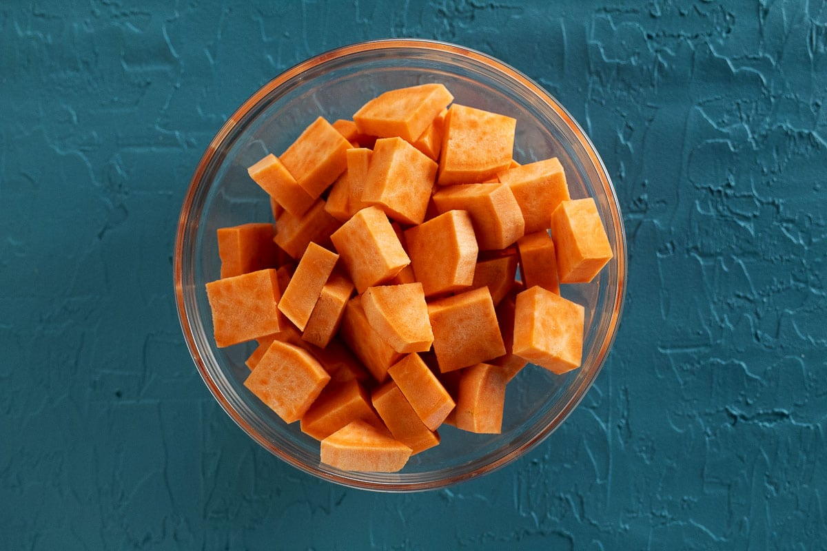 This is an image of the sweet potatoes sliced and diced into quarter-inch thick by one-inch pieces.
